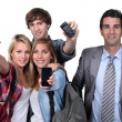 Teenagers showing phones — Stock Photo