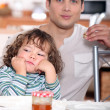 Father having crepes with his child — Stock Photo #8469923