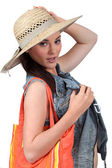 Girl with straw hat on white background — Stock Photo