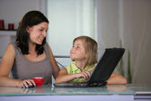 Mother and daughter using a laptop — Stock Photo