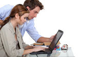 A couple of student over their laptop. — Stock Photo