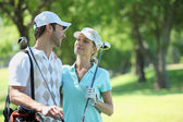 Portrait of a couple in golf clothes — Stock Photo