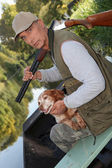 Senior hunting with his dog — Stock Photo