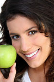 Brunette woman and an apple — Stock Photo