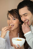 Couple eating cereal — Stock Photo