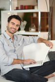 Man in front of computer — Stock Photo