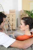 Young couple in new apartment — Stock Photo
