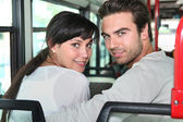 Young couple sitting on a bus — Stock Photo