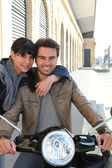 Woman hugging a man on a motorcycle — Stock Photo