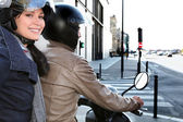 Trendy couple on a moped — Stock Photo