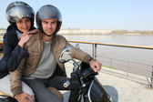 Urban couple on a scooter — Stock Photo