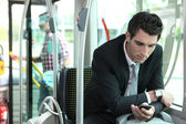 Man texting in a bus — Stock Photo