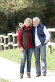 Couple walking in the countryside — Stock Photo
