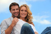 Couple in blue sky — Stock Photo