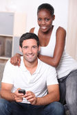 Man and woman watching television — Stock Photo