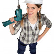 A female construction worker holding a drill. — Stock Photo #8470002