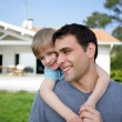 Father and son stood in the front yard — Stock Photo