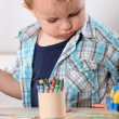 Stock Photo: Little boy with crayons