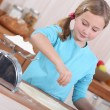 Little girl making pancakes — Stock Photo