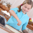 Little girl making pancakes — Stock Photo #8470453