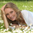 Stock Photo: Womlying in grassy field