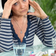 Mature woman having a headache - Stock Photo