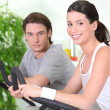 Stock Photo: Couple working out together in gym