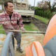 Man with a cement mixer — Stock Photo #8471585