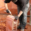 Man shaping a brick — Stock Photo