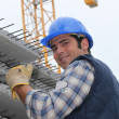 Construction worker with slabs of reinforced concrete - Stock Photo