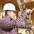Carpenter measuring a door frame — Stock Photo