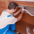 Plumber fixing a pipe — Stock Photo