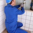 Plumber repairing water pipes — ストック写真