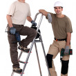 Stock Photo: Two workers posing with drills
