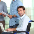 Young man in wheelchair — Stock Photo