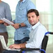 Young man in wheelchair - Stock Photo