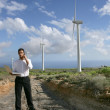 Man with a phone and laptop on a wind farm — Stock Photo #8475373