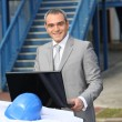 Stock Photo: Smiling contractor standing outdoors