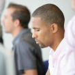 Men concentrated in front of screen — Stock Photo #8475759