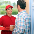 Portrait of a delivery girl - Stock Photo