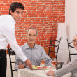 Elderly couple dining — Stock Photo