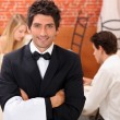 Stock Photo: Waiter in restaurant