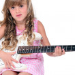 Little girl playing guitar — Stock Photo #8476166