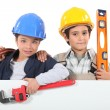 Kids dressed up as builders — Stock fotografie #8476174