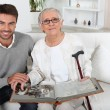 Elderly person looking at photos with son - Foto Stock