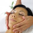 Woman receiving face massage — Stock Photo #8476657