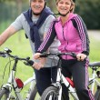 Stock Photo: Couple having bike ride