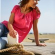 Woman sat on boat - Stock Photo