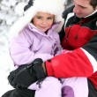 Father and daughter in snowsuits — Stock Photo