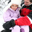 Father and daughter in snowsuits — Stockfoto